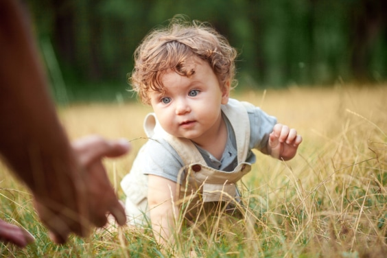 Little Baby Or Year Old Child On The Grass